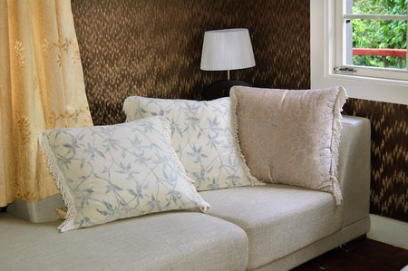 Detail of modern living room with table lamp and pillow cushions on sofa Stock Photo - 7499143