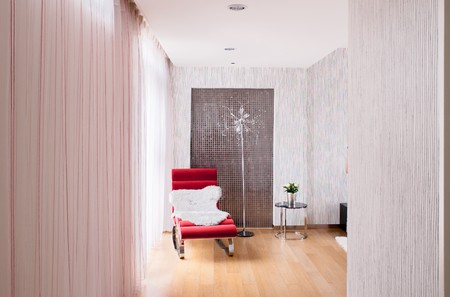 Modern interiors with longue chair by the window photo