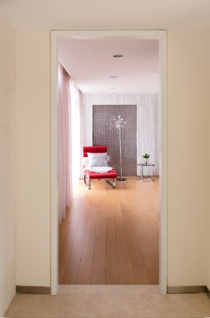 hotel door: Modern interiors with longue chair by the window Stock Photo