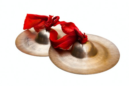 cymbals: Chinese tradition percussion instrument - China small cymbals isolated on white,  usually it used  with the gong and  the drum together forms the Chinese percussion instrument team .