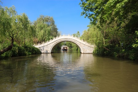 White stone footbridge in an Asian garden photo
