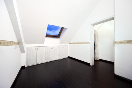 New modern attic room with a roof skylight window and wall cabinet Stock Photo - 7938749