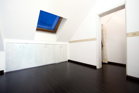 New modern attic room with a roof skylight window and wall cabinet Stock Photo - 7938762