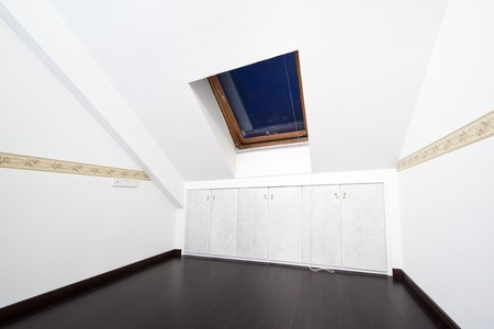 New modern attic room with a roof skylight window and wall cabinet Stock Photo - 7938757
