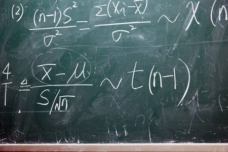 mathematical formulas on a green blackboard at classroom Stock Photo - 7938796