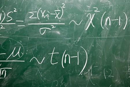 mathematical formulas on a green blackboard at classroom Stock Photo - 7938795