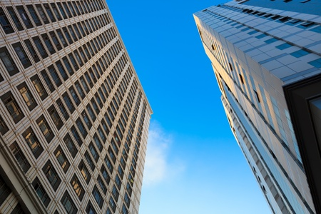 Looking up at the architecture of Skyscrapers with blue sky backgournd in a  modern city . Stock Photo
