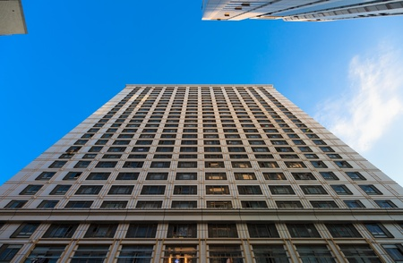 tall glass: Looking up at the architecture of Skyscrapers with blue sky backgournd in a  modern city . Stock Photo