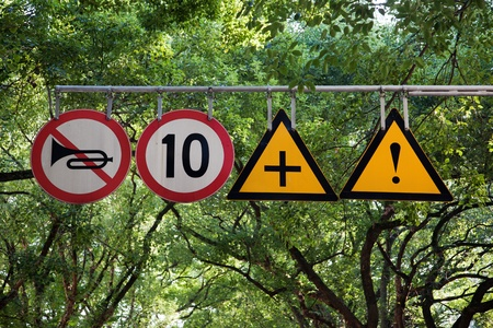 Four road signs with warning and speed limit on it in a city park Avenue Stock Photo - 8681749