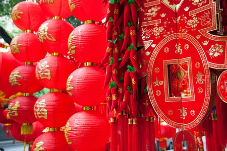 Chinese red lanterns decorations in a traditional open market during Spring Festival.Normally there have some characters or drawing on it for good lucky and best wish for the new year to come. photo