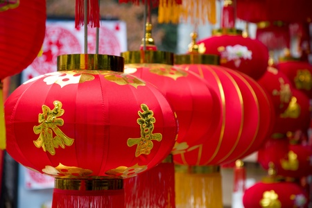 Chinese red lanterns in a traditional open market during Spring Festival.Normally there have some characters or drawing on lanterns for good lucky and best wish for the new year to come. photo