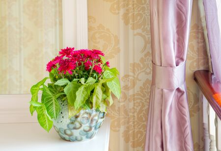 Bouquet of flowers on a dressing table in a living room photo