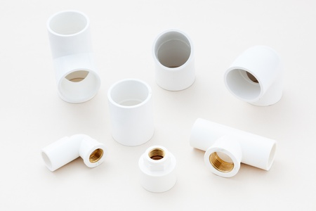 Group of combined fittings for PVC pipes in studio photo
