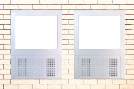Two small led displays with empty frame on brick wall,these machines are typically used for advertising in some new buildings. Add you own image  or design. Stock Photo - 9663442