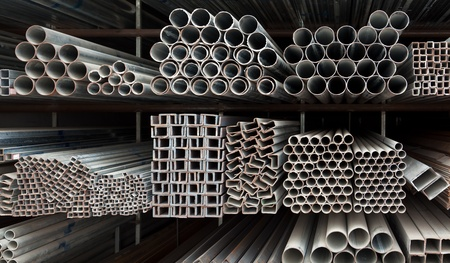 aluminum rod: Metal pipe stack on shelf Stock Photo