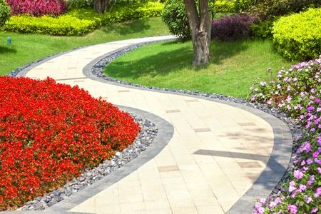 garden patio: Beautiful summer garden with a walkway winding its way through