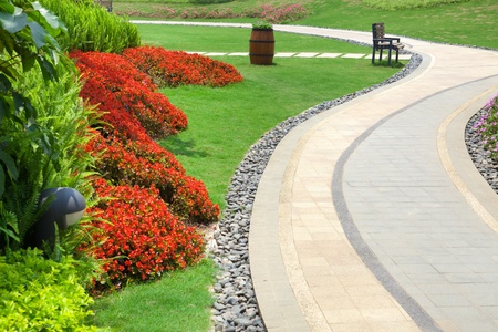 ornamental horticulture: Beautiful summer garden with a walkway winding its way through