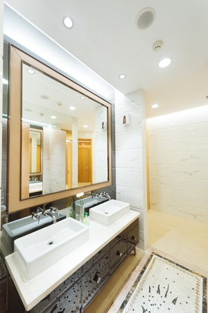 showcase interiors: Iterior of a modern bathroom with basin and mirror  at a new house
