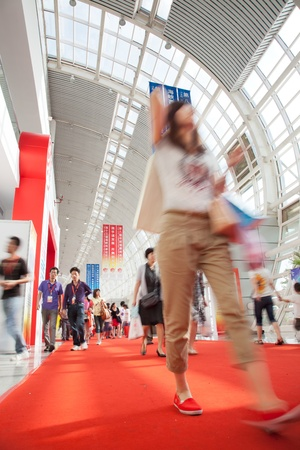Visitors walking inside Fujian Straits International Convention and Exhibition Center.The 13TH Cross-Straits Fair for Economy and Trade held on May 18 to 21,2011 in Fuzhou, capital of Fujian Province. The five-day fair attracted 643,000 visitors, with 308 Stock Photo - 10604365