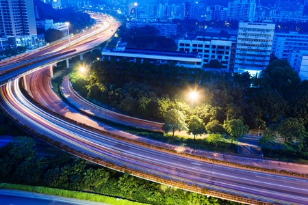 junctions: A road junction with blurred colorful lines at dawn