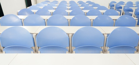 Rows of desks and chairs in a modern training room photo