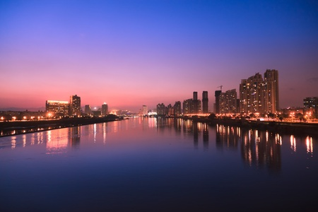 City skyline at twilight.Cityscape  by the river of Minjiang,Fuzhou,China photo
