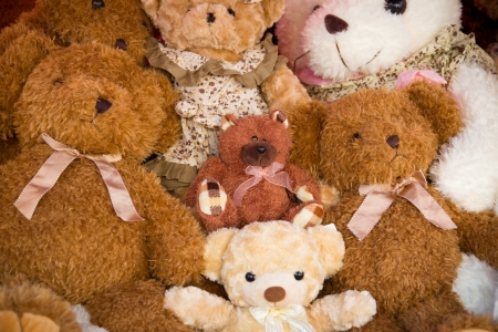 A stack of stuffed toy bear in a  very fortunate child Standard-Bild