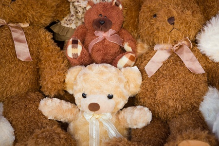 A stack of stuffed toy bear in a  very fortunate child photo