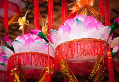 Variety of colorful Chinese Paper Lanterns in a street market in China. photo