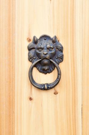 lion door knob on wood photo