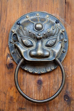 Chinese unicorn door knob on wood.Chinese unicorn, also name kylin,is an auspicious symbol in china Stock Photo - 12282370