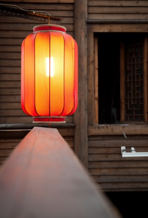 Hanging red lantern on the traditional wooden wall background Stock Photo - 12631633