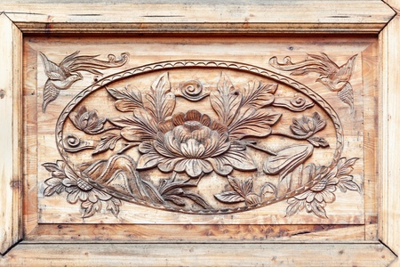 Pattern of flower carved on wood Part of decoration on the Chinese wooden window   photo