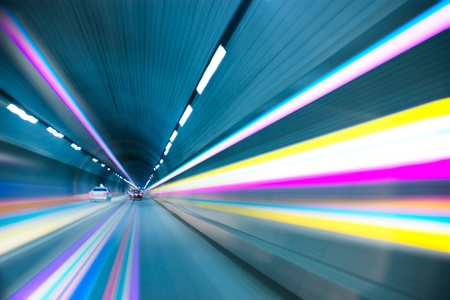 Abstract speed motion in urban highway road tunnel, blurred motion toward the light photo