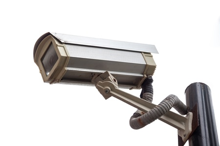 Surveillance high-definition camera isolated on white background photo