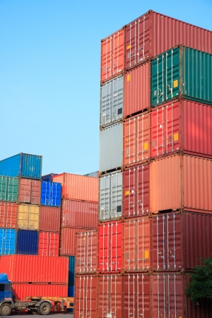 Stack of Cargo Containers at sunrise in an intermodal yard photo