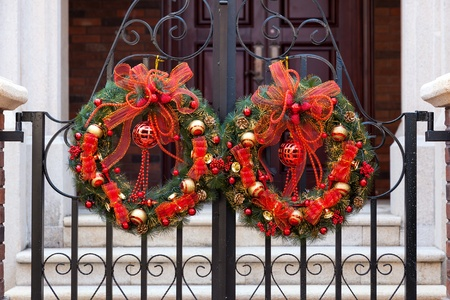 door leaf: Christmas decorative Wreath with colorful balls and fringe hanging in Front of door