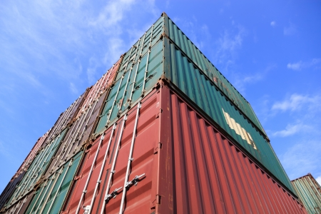 intermodal: Upward view for stack of Cargo Containers under blue sky at sunrise in an intermodal yard  Stock Photo