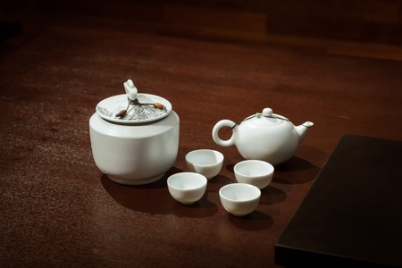 teaset: Tea  Set on a Wooden Table in a traditional asian tearoom, include  teapot and teacups and tea caddy