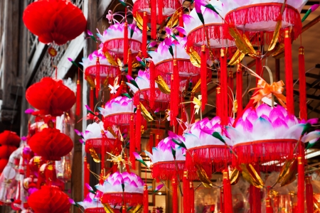A row of hanging paper lotus festival lanterns for Chinese Lantern festival in market  photo