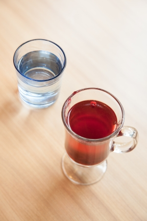 cranberry fruit: Red cranberry fruit drinks and vodka in glass