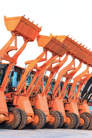dredging tools: Row of heavy construction excavator machine Stock Photo