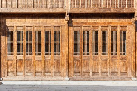 The traditional wooden doors with lattice windows,which has the style of typical architecture of southern China in the Ming and Qing Dynasties. Three lanes and seven alleys, Fuzhou,China