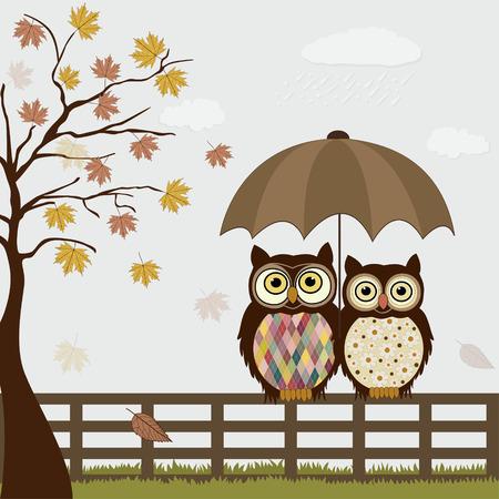 Hiboux mignons sur une cl�ture en automne