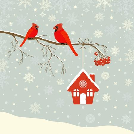 Leuke rode hoofdvogel met vogelhuis op tak in de winter