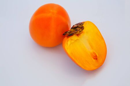ripe persimmons isolated on a white background