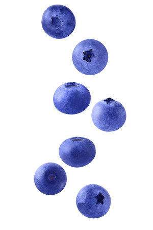 Isolated flying berries. Seven  falling blueberry fruits isolated on white background with clipping path