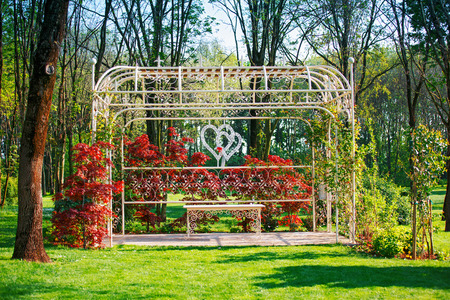 Wedding arch decorated in the garden. Beautifully decorated and romantic wedding. Stone gazebo decorated for wedding ceremony. Editorial