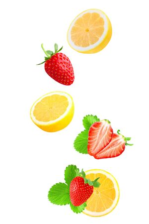 Falling strawberry and lemon isolated on white background Stock Photo