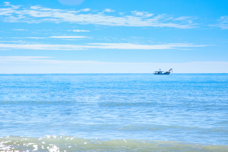 fishing boat in the sea early in the morning.